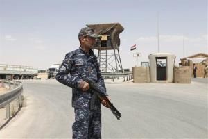 An Iraqi soldier stands guard in al-Walid border crossing, west of Baghdad, Iraq, Saturday, July 21, 2012.