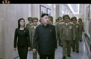 In this Feb. 16, 2013 image made from video, North Korean leader Kim Jong Un, center, and his wife Ri Sol Ju tour as they visit the Kumsusan Palace of the Sun in Pyongyang,