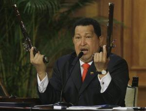 July 24, 2012: Hugo Chavez holds up a pair of pistols that he says belonged to Venezuela's independence hero Simon Bolivar.