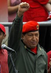 Hugo Chavez greets members of the National Revolutionary Militia during the Militia Day celebrations in Caracas, Tuesday, April 13, 2010.