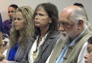 Aerosmith lead singer Steven Tyler, center, sits with his attorney Dina LaPolt, left, and Fleetwood Mac drummer Mick Fleetwood during testimony last month.