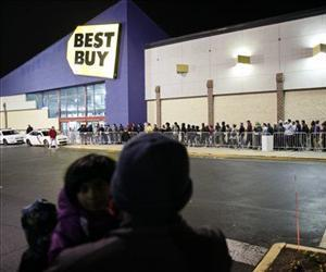 In this Thursday Nov 22, 2012 file photo, people wait in line for a Best Buy store to open in Northeast Philadelphia.