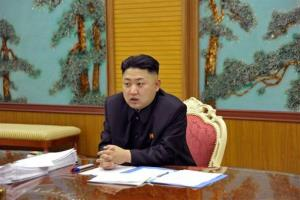 Kim Jong Un attends a consultative meeting with officials at undisclosed location in North Korea at an undisclosed date.