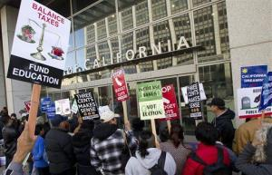 Demonstrators protest state budget cuts to education at the California State Office Building Thursday, March 1, 2012, in San Francisco.