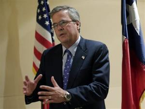 In this Feb. 26, 2013, file photo, former Florida Gov. Jeb Bush talks with the media following his address on education to the Texas Business Leadership Council in Austin, Texas.