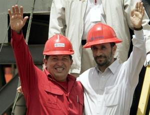 In this 2006 file photo, Venezuela's Hugo Chavez, left, and Iran's President Mahmoud Ahmadinejad wave to the press after inaugurating an oil drill in San Tome, Venezuela.
