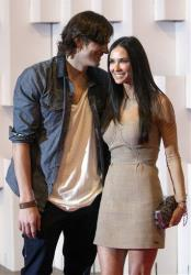 Actors Ashton Kutcher, left, and Demi Moore pose for pictures on the red carpet at the Sao Paulo Fashion Week in Sao Paulo, Brazil, Sunday Jan. 30, 2011.