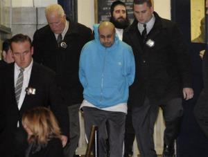Julio Acevedo is taken from the 78th precinct in the Brooklyn borough of New York, Thursday, March 7, 2013.