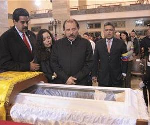 Nicolas Maduro, Venezuela's acting president, Nicaragua's President Daniel Ortega, and his wife Rosa Murillo, mourn next to Hugo Chavez's coffin during his wake at a military academy in Caracas.