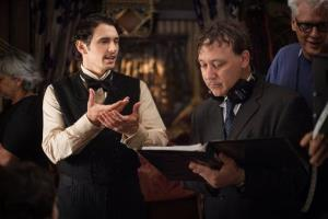 This film image released by Disney Enterprises shows James Franco, left, and director Sam Raimi on the set of Oz the Great and Powerful.