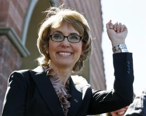 In this March 6 file photo, Gabrielle Giffords greets a crowd in Tucson.
