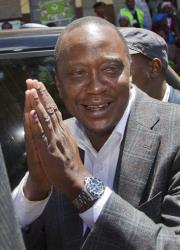 Uhuru Kenyatta gestures to voters after casting his vote on March 4 in the Kenya election.