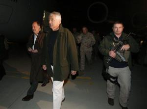 Defense chief Chuck Hagel, center, walks with U.S. Ambassador to Afghanistan James Cunningham, left,  upon arrival in Kabul.