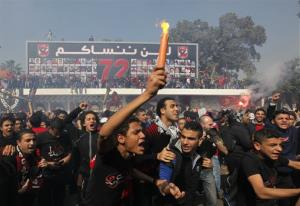 Egyptian soccer fans of Al-Ahly club celebrate in front of their club in Cairo, Egypt, Saturday, March 9, 2013.