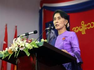 Myanmar's opposition leader Aung San Suu Kyi speaks during the congress of her National League for Democracy party at Royal Rose restaurant in Yangon, Myanmar, Sunday, March 10, 2013.