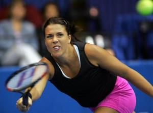 In this file photo made Nov. 3, 2004, Jennifer Capriati stretches for the ball during her match with Meghann Shaughnessy at the Advanta Championships in VIllanova, Pa.