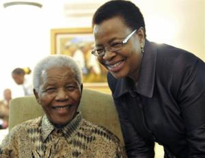 FILE  -  May 16, 2011 file photo supplied by the South African Government Communications and Information Services, GCIS, showing former South African President Nelson Mandela and his wife Graca Machel  at his home in Johannesburg, South Africa. Mandela was admitted to a hospital on Saturday March 9 2013 for a...