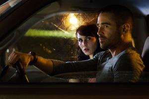 This film image released by FilmDistrict shows Noomi Rapace , left, and Colin Farrell in a scene from Dead Man Down.