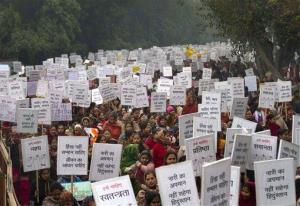 Indian women carry placards as they march to mourn the death of a gang rape victim in New Delhi, India.