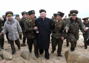 North Korean leader Kim Jong Un, center, walks with military personnel as he arrives  on Mu Islet in the southernmost part of the southwestern sector of North Korea's border with South Korea.