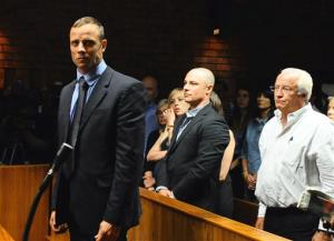 Oscar Pistorius stands following his bail hearing.