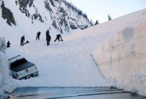 This image provided by the National Park Service shows workers searching a snow-blocked Sylvan Pass inside Yellowstone National Park May 11, 2011 in Montana.