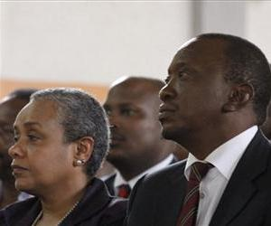 Kenya's President-elect Uhuru Kenyatta, right, attends church service in Gatundu Catholic Church with his wife Margaret Kenyatta in his hometown of Gatundu, March 10, 2013.