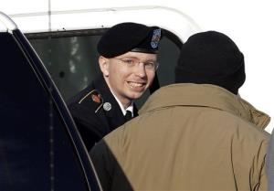 In this Nov. 28, 2012 file photo, Army Pfc. Bradley Manning steps out of a security vehicle as he is escorted into a courthouse in Fort Meade, Md., Wednesday, Nov. 28, 2012.