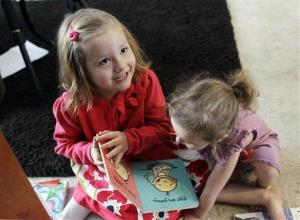 In this Monday, Feb. 25, 2013, photo, Coy Mathis, left, plays with her sister Auri, at their home in Fountain, Colo.  Coy has been diagnosed with Gender Identity Disorder.