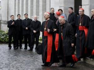 US Cardinals Donald Wuerl, Timothy Dolan, Francis George and Roger Mahony exit the North American College to go to the Vatican hotel where the cardinals stay during the conclave.