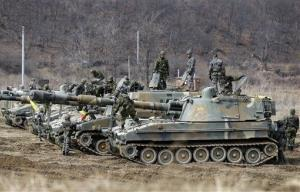 South Korean soldiers work on their armored vehicles during an exercise near the border village of Panmunjom, in Paju, north of Seoul, South Korea, Tuesday, March 12, 2013.