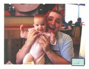 This undated file photo submitted into evidence by defense attorney Julia L. Gatto shows New York City police Officer Gilberto Valle with his daughter.