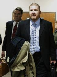 Defense attorney Daniel King arrives at district court for the arraignment of James Holmes, Aurora theater shooting suspect, in Centennial, Colo., on Tuesday, March 12, 2013.