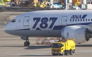An All Nippon Airways Boeing 787 Dreamliner parks on the tarmac at Haneda airport in Tokyo.
