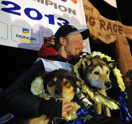 Mitch Seavey became the oldest winner and a two-time Iditarod champion when he drove his dog team under the burled arch in Nome on Tuesday evening, March 12, 2013.