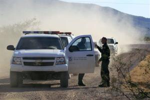 In this Oct. 2, 2012 file photo, US Customs and Border Protection officers and other law enforcement drive the roads in Bisbee, Ariz.