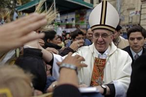 In this Aug. 7, 2009 file photo, Argentina's Cardinal Jorge Bergoglio, right, greets faithful outside the San Cayetano church in Buenos Aires. On Wednesday, March 13, 2013, Bergoglio was elected pope.