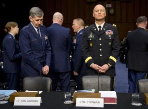 Lt. Gen. Richard Harding, Judge Advocate General of the United States Air Force, left, and Lt. Gen. Dana Chipman, Judge Advocate General of the United States Army, wait testify on Capitol Hill in Washington, Wednesday, March 13, 2013, before the Senate subcommittee on Personnel hearing on sexual assault in the...