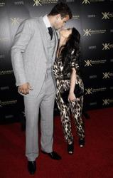 Kim Kardashian and Kris Humphries arrive at the Kardashian Kollection launch party in Los Angeles, Wednesday, Aug. 17, 2011.