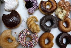 A box of half-eaten Tim Hortons' donuts is seen after a tasting in New York, Wednesday, July 22, 2009. The Canadian doughnut chain moved into 12 former Dunkin Donut locations earlier in the month, bringing new blood to the doughnut war in America's most competitive market.