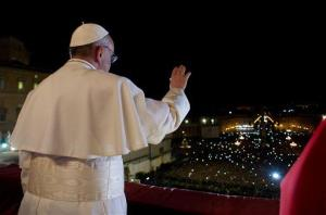 In this photo provided by the Vatican newspaper L'Osservatore Romano, Pope Francis waves from the balcony of St. Peter's Basilica at the Vatican Wednesday.