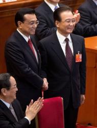 New Chinese Premier Li Keqiang, left, poses with his predecessor Wen Jiabao Friday, March 15, 2013.