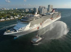 The Carnival Legend, a 2,100-passenger, 960-foot-long cruise ship arrives at Port Everglades in Fort Lauderdale, Fla., in this 2002 file photo.