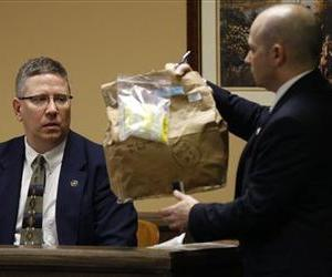 Prosecutor Brian Deckert asks Bureau of Criminal Investigation Special Agent Ed Lulla about an evidence bag containing a blanket, March 14, 2013 in Steubenville, Ohio.