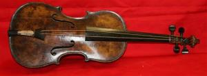 In this undated photo provided by Henry Aldridge on Friday, March 15, 2013 shows the violin that was played by the bandmaster of the Titanic as the oceanliner sank, Devizes, England.