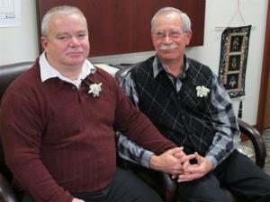 Tim LaCroix, left, and Gene Barfield relax in the tribal chairman's office, Friday, March 15, 2013, in Harbor Springs, Mich., after getting married.