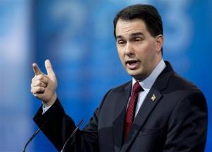 Wisconsin Gov. Scott Walker gestures as he speaks at the CPAC convention.