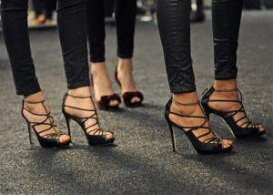 Models wear their runway shoes backstage before the showing of the Badgley Mischka Fall  2013 collection during Fashion Week, Tuesday, Feb. 12, 2013, in New York.