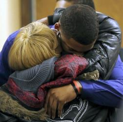 Ma'lik Richmond hugs his mother Daphne Birden after closing arguments in the trial for Ma'lik and Trent Mays on rape charges on Saturday, March 16, 2013, in Steubenville, Ohio.