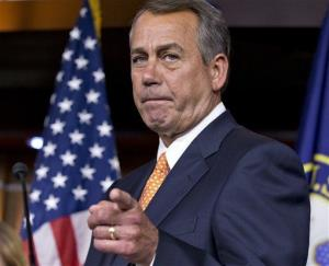 In this March 13, 2013 file photo, House Speaker John Boehner gestures as he speaks to reporters, on Capitol Hill.